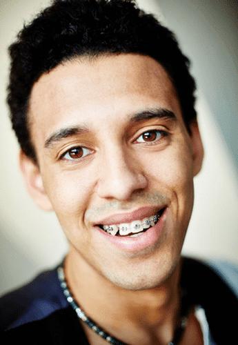 close up of stylish young man wearing braces